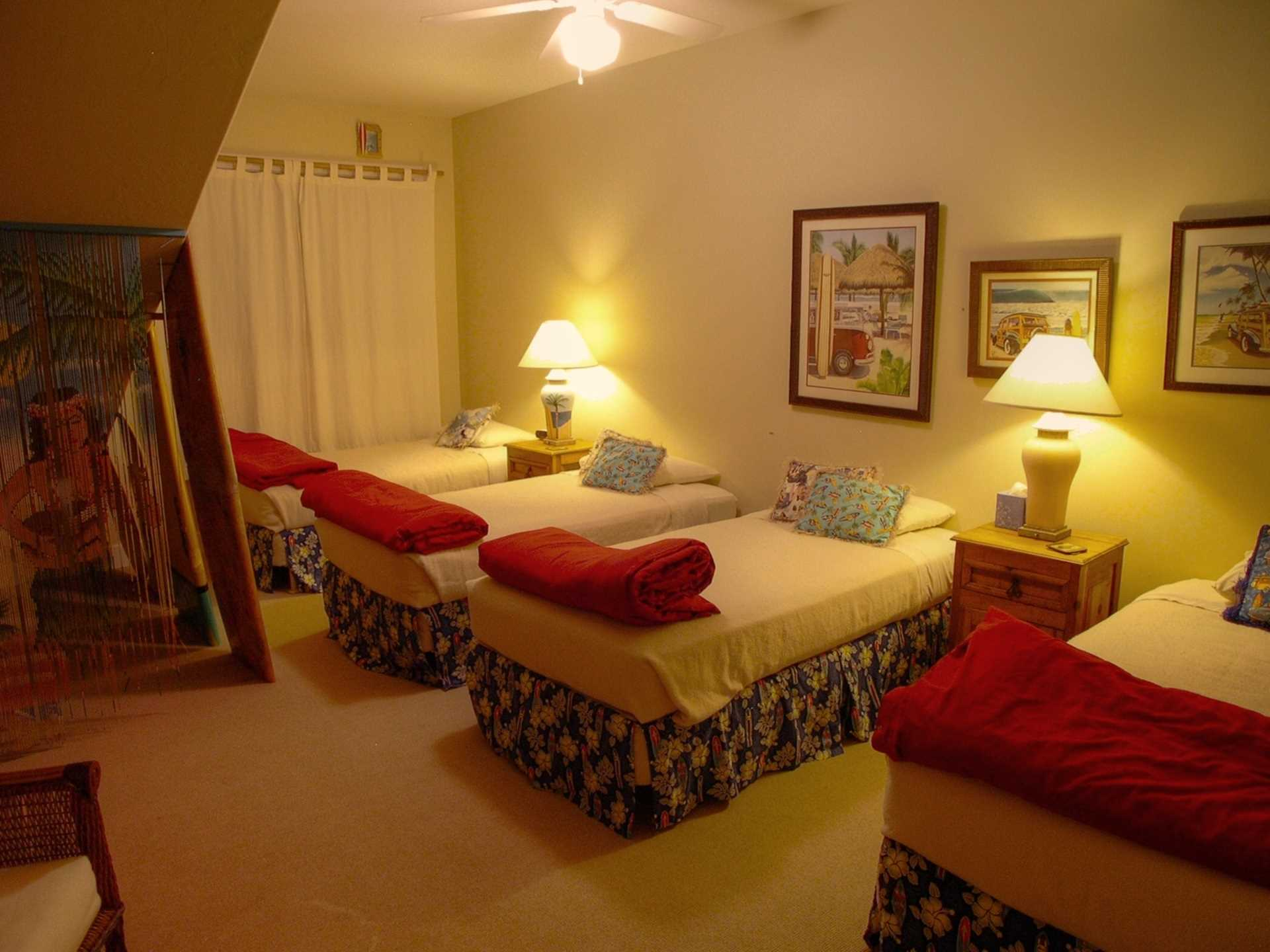 The Surfer's Bedroom is colorfully decorated with surf board