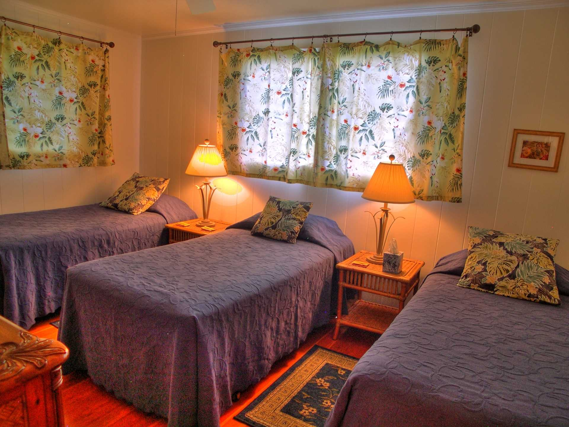 The Blue Room with hardwood floor features three twin beds (