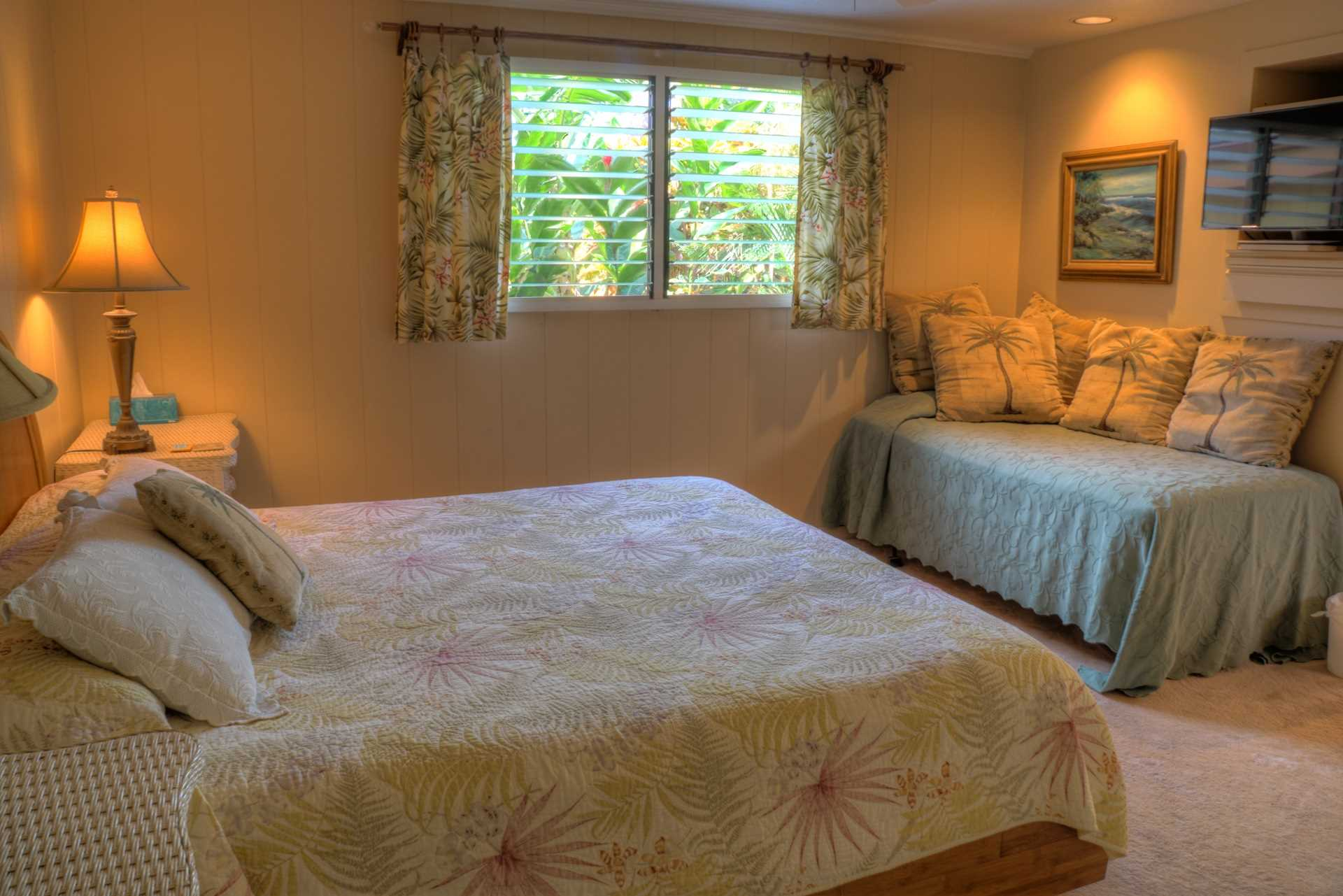 The lower master suite features a king bed with daybed and l