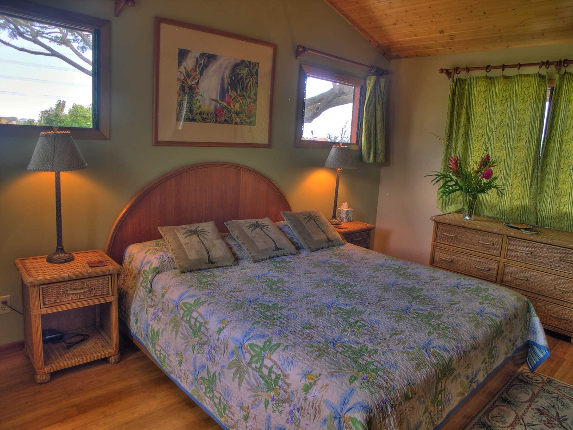 The upper master suite is a delightful, airy room above the
