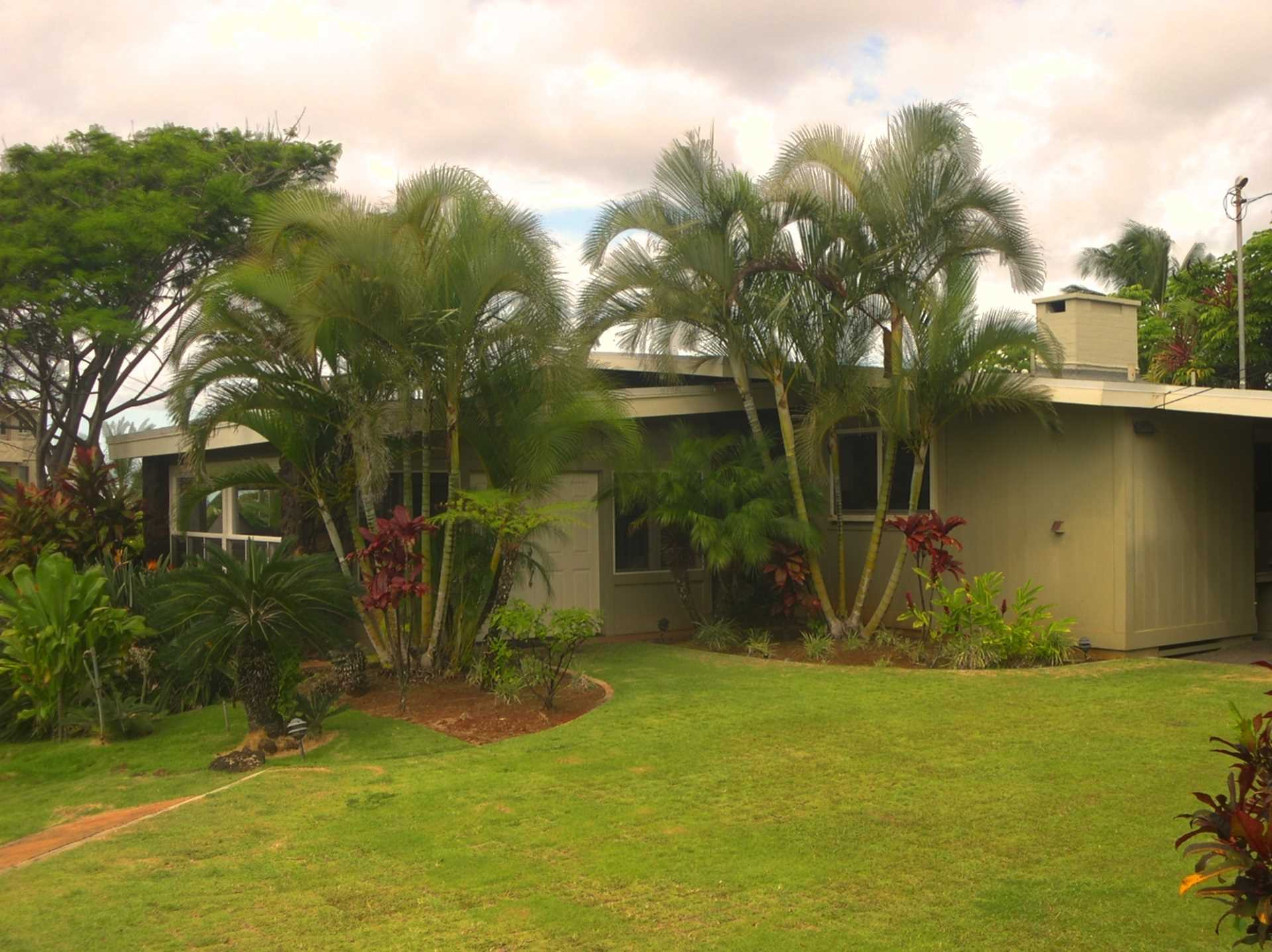 The home is located on a rise overlooking Kauai's southern c
